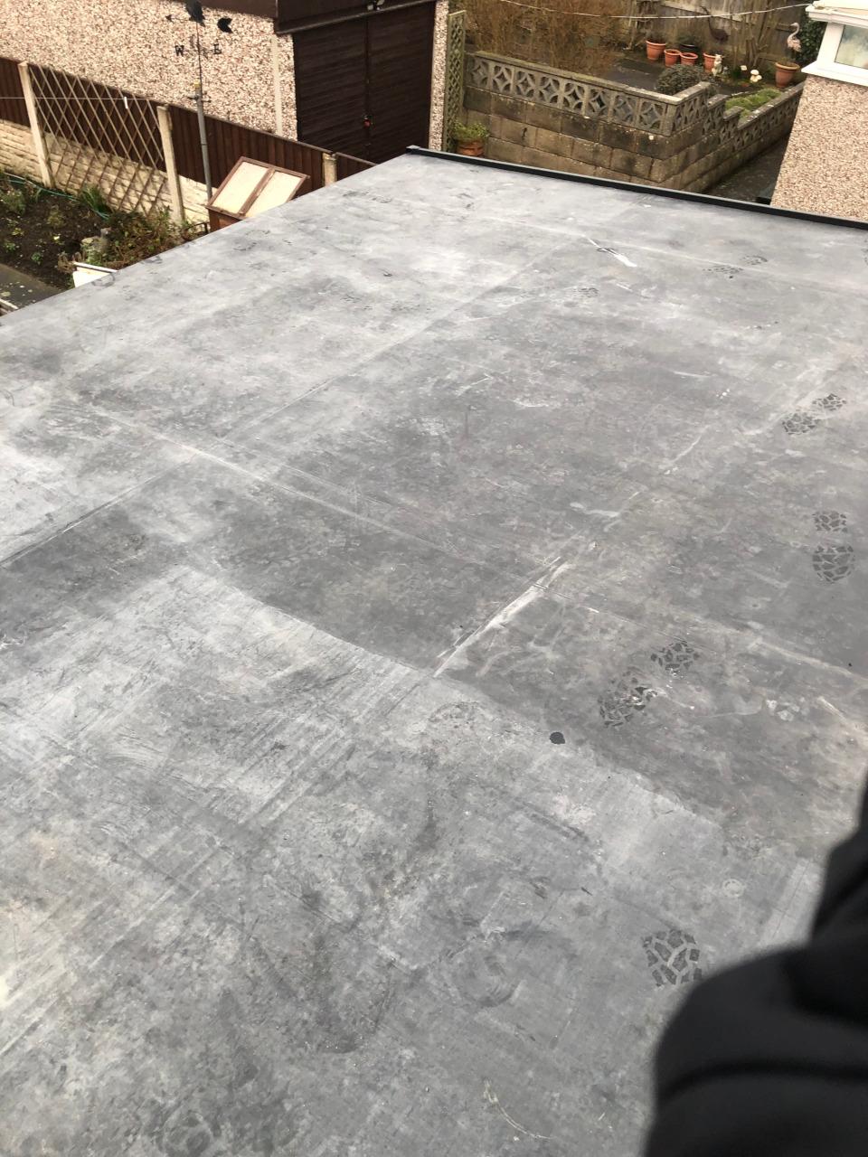 Felt flat roof repair in Llandudno.