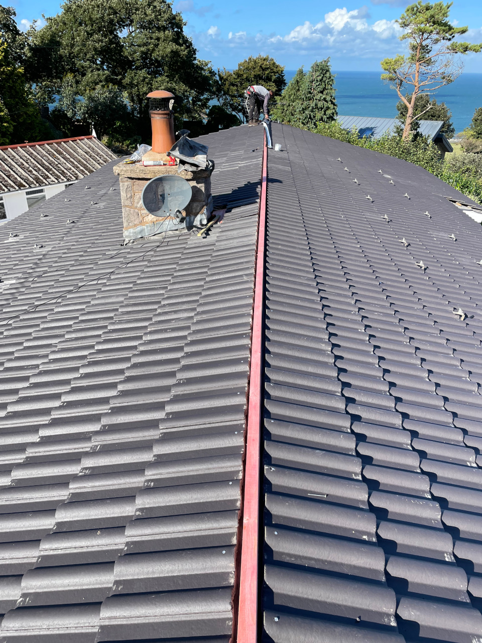 Mechanically fixed ridge tiles in Abergele.